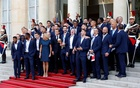 French President Emmanuel Macron and his wife Brigitte Macron pose with France soccer team captain Hugo Lloris holding the trophy, coach Didier Deschamps and players before a reception to honour the France soccer team after their victory in the 2018 Russia Soccer World Cup, at the Elysee Palace in Paris, France, July 16, 2018. Reuters