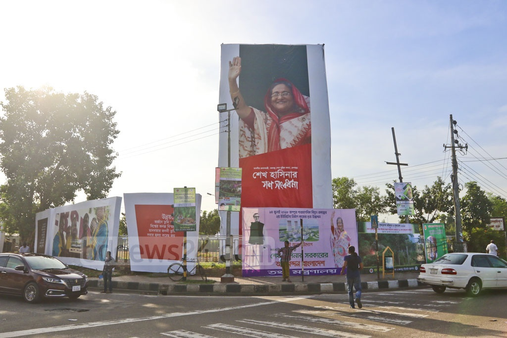 The streets of Dhaka are decorated with posters, festoons and billboards on Wednesday ahead of a reception for Prime Minister Sheikh Hasina by her Awami League party at the Suhrawardy Udyan on Saturday. Photo: Abdullah Al Momin