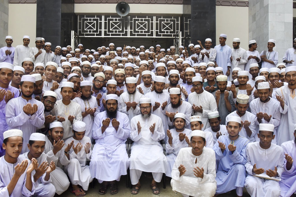 Teachers and students of Darunnazat Siddikia Kamil Madrasa at Dhaka's Demra offer special prayers after publication of results of HSC and equivalent exams on Thursday.