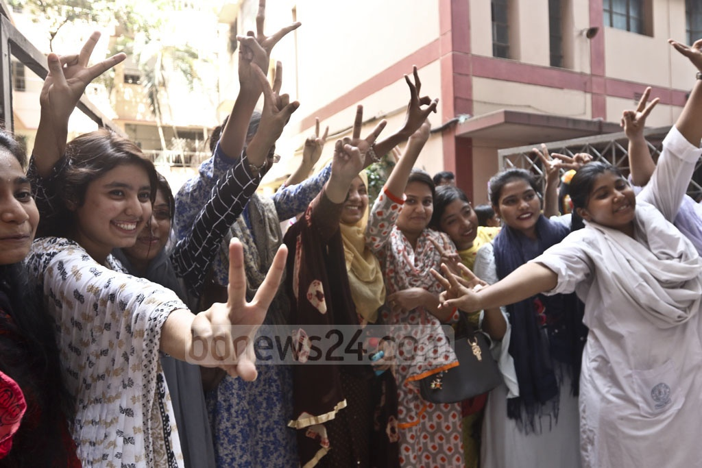 Students celebrate publication of HSC exam result at Motijheel Ideal School and College in Dhaka on Thursday. Photo: Abdullah Al Momin