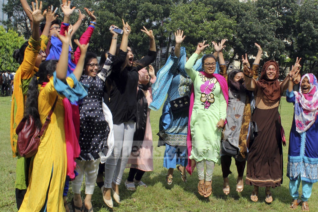 Students celebrate publication of HSC exam result at RAJUK Uttara Model College in Dhaka on Thursday.