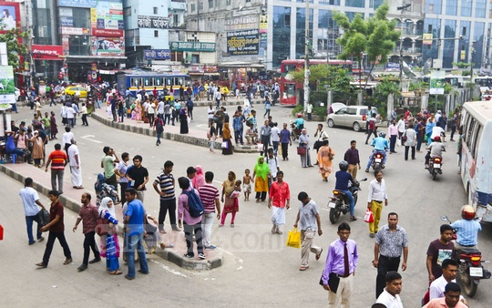 Commuters wait anxiously in Farmgate to catch a ride home after office hours on Thursday as a lack of public transport hit the capital in Dhaka on the last working day of the week.