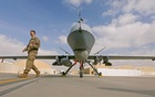 Photo Caption: US service member passes in front of a MQ-9 Reaper drone, one of a squadron that has arrived to step up the fight against the Taliban, at the Kandahar air base, Afghanistan Jan 23, 2018. Reuters