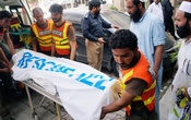 Rescue workers move the body of Ikramullah Gandapur, a candidate of the Pakistan Tehreek-e-Insaf (PTI), or Pakistan Justice Movement, who was killed in a suicide attack in the northwestern province of Khyber Pakhtunkhwa, outside hospital morgue in Dera Ismail Khan, Pakistan July 22, 2018. Reuters
