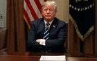 US President Donald Trump waits for reporters to leave the room after speaking about his summit with Russia's President Putin during a meeting with members of the US Congress at the White House in Washington, Jul 17, 2018. Reuters
