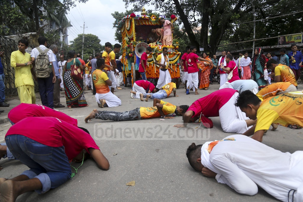 Hindu devotees bowing on the street before the chariot of Lord Jagannath during Ulto (reverse) Rath Yatra in Dhaka on Sunday.