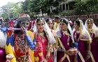 Hindus wearing costumes of Lord Krishna and Radha during Ulto (reverse) Rath Yatra in Dhaka on Sunday.