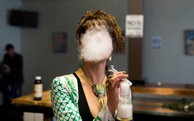 File Photo: Elise McRoberts exhales after using a full spectrum oil vaporizer at the new Magnolia cannabis vape lounge in Oakland, California, US, Apr 20, 2018. Reuters