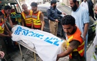 Rescue workers move the body of Ikramullah Gandapur, a candidate of the Pakistan Tehreek-e-Insaf (PTI), or Pakistan Justice Movement, who was killed in a suicide attack in the northwestern province of Khyber Pakhtunkhwa, outside hospital morgue in Dera Ismail Khan, Pakistan Jul 22, 2018. Reuters