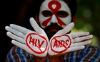 Photo Caption: A student displays his hands painted with messages as he poses during an HIV/AIDS awareness campaign to mark the International AIDS Candlelight Memorial, in Chandigarh, India, May 20, 2018. Reuters