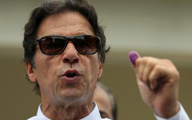 Cricket star-turned-politician Imran Khan, chairman of Pakistan Tehreek-e-Insaf (PTI), speaks to members of media after casting his vote at a polling station during the general election in Islamabad, Pakistan, July 25, 2018. REUTERS/Athit Perawongmetha