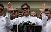 Cricket star-turned-politician Imran Khan, chairman of Pakistan Tehreek-e-Insaf (PTI), speaks to members of media after casting his vote at a polling station during the general election in Islamabad, Pakistan, Jul 25, 2018. Reuters