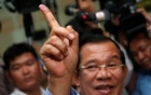 Cambodia's Prime Minister and President of the Cambodian People's Party (CPP) Hun Sen shows his stained finger at a polling station during a general election in Takhmao, Kandal province, Cambodia Jul 29, 2018. Reuters