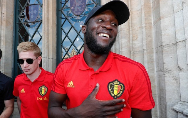 Football - World Cup - Belgium - Brussels, Belgium - July 15, 2018. Belgian soccer team players Kevin De Bruyne and Romelu Lukaku reacts while appearing on the balcony of the city hall at the Brussels' Grand Place, after taking the third place in the World Cup 2018, in Brussels, Belgium July 15, 2018. Reuters