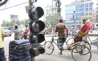 A traffic signal hangs from a rope in the Uttara House Building area. Photo: Asif Mahmud Ove