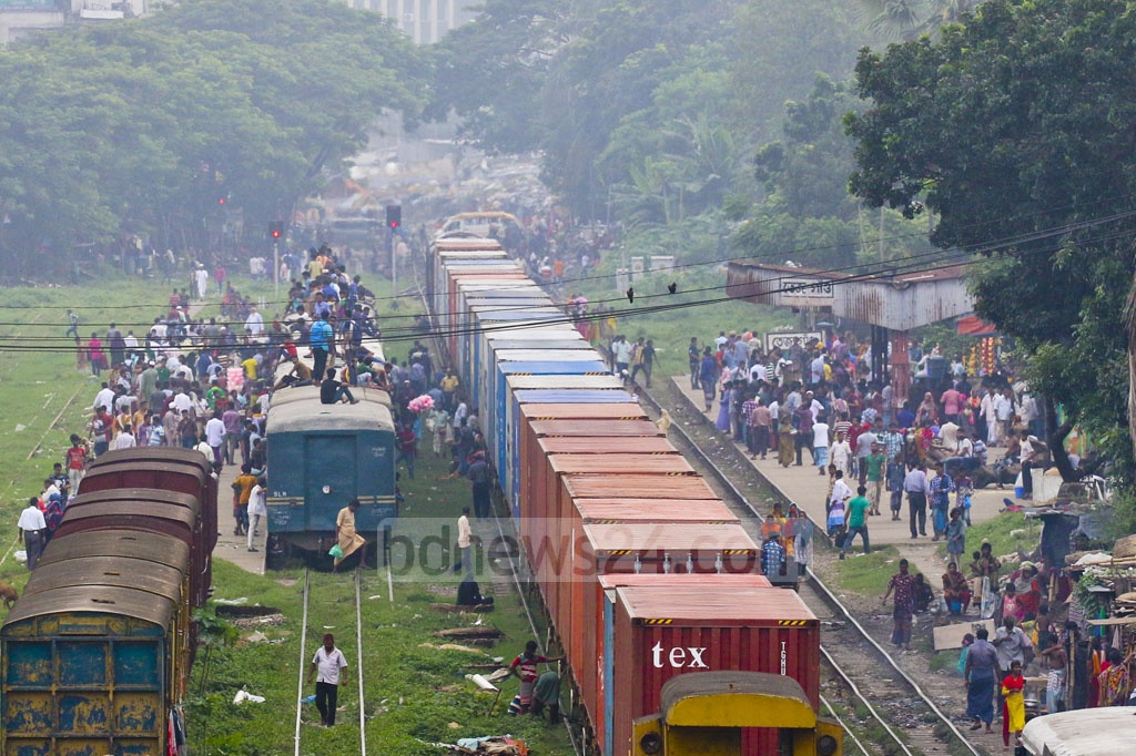 Many are forced to take risky rides on train roofs as transporters have taken buses off the road in response to student protests for safe roads. The photo shows the situation at Tejgaon/Moghbazar in Dhaka on Sunday. Photo: Abdullah Al Momin