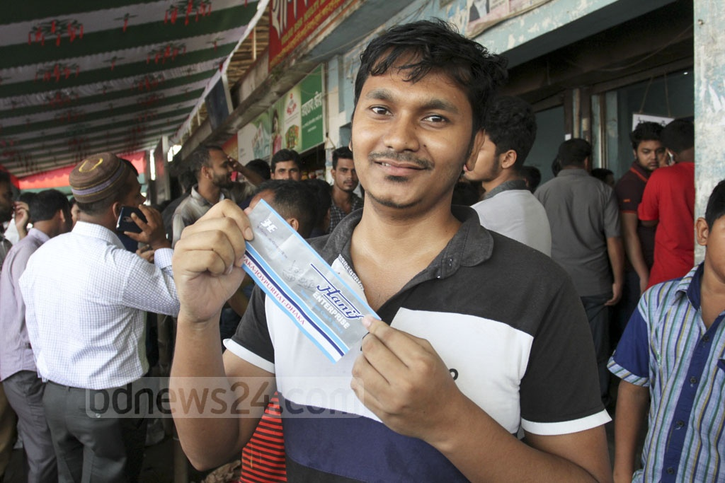 The long wait is over—his smile says it all. A customer secured a ticket to his desired destination for Eid. The photo was taken at Dhaka's Gabtoli bus terminal on Tuesday. Photo: Asif Mahmud Ove