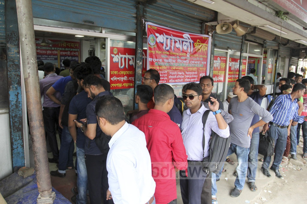 People wait to buy advance tickets for Eid holidays at Kalyanpur bus counter. Photo: Asif Mahmud Ove
