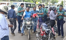 Police checking driving licence and other papers at Hare Road in Dhaka on Tuesday during the National Traffic Week. Photo: Abdullah Al Momin