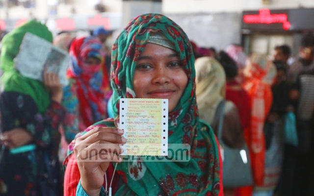 A woman displays her advance train ticket bought from the Kamalapur Railway Station in Dhaka on Wednesday. Photo: Abdullah Al Momin