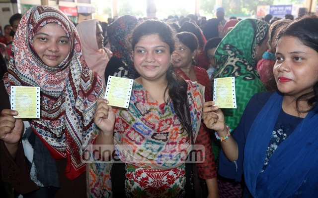 Three women smile as they bought tickets to their destinations for Eid travels. The photo was taken at the Kamalapur Railway Station on Wednesday. Photo: Abdullah Al Momin