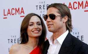 Cast member Brad Pitt and actress Angelina Jolie pose at the premiere of