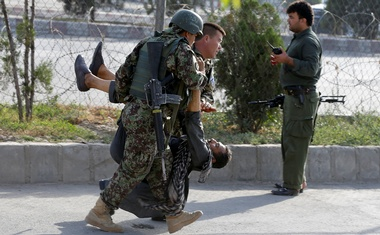 Afghan soldiers carry an injured man after a blast in Kabul, Afghanistan Jul 22, 2018. Reuters