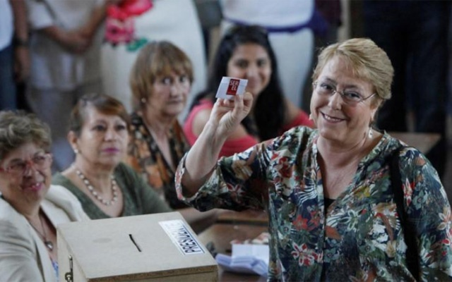 Chilean president Michelle Bachelet shows her ballot during the presidential election in Santiago, Chile Dec 17, 2017. REUTERS