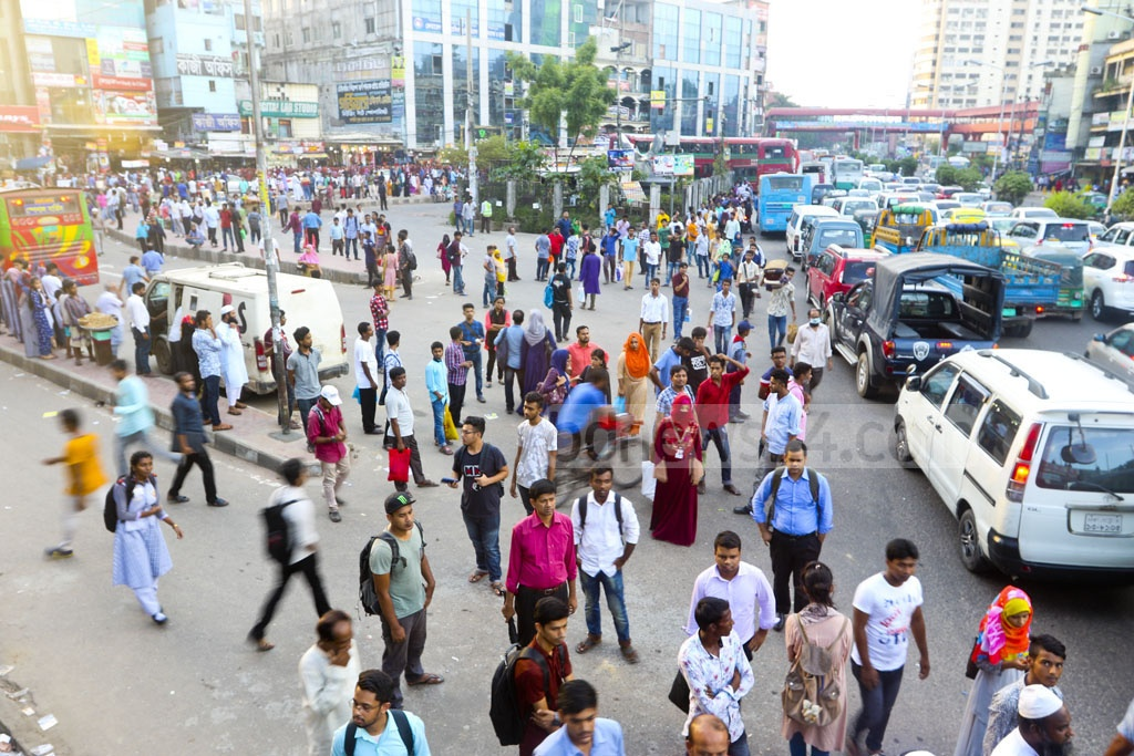 Commuters had to wait for long to catch a ride back home after work at Farmgate due to lack of public transport on the last working day of the week on Thursday. Photo: Abdullah Al Momin