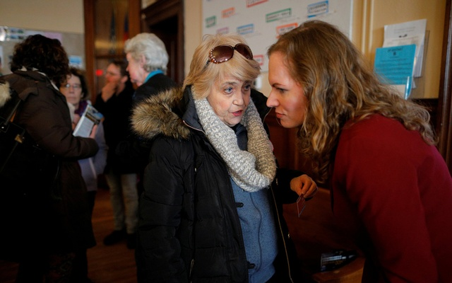 Democratic candidate for the US Congress Alexandra Chandler, a transgender, former Naval Intelligence analyst, talks to a voter after the Greater Haverhill Indivisible candidates forum in Haverhill, Massachusetts, US, Jan 27, 2018. Reuters