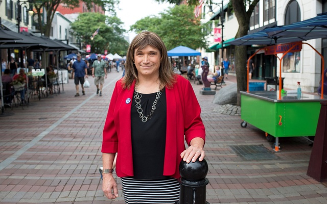Vermont Democratic Party gubernatorial primary candidate Christine Hallquist, a transgender woman, poses as she campaigns on Church Street in Burlington, Vermont, US, Aug 8, 2018. Reuters