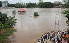 People stand on the steps of Aluva Shiva Temple complex submerged in water after the opening of Idamalayar dam shutter following heavy rains, on the outskirts of Kochi, India, Aug 9, 2018. Reuters