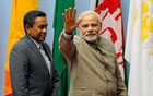 FILE PHOTO: India's Prime Minister Narendra Modi (R) waves as Maldives President Abdulla Yameen looks on during the closing session of 18th South Asian Association for Regional Cooperation (SAARC) summit in Kathmandu November 27, 2014. Reuters