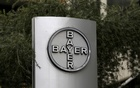 File Photo: The corporate logo of Bayer is seen at the headquarters building in Caracas, Venezuela Mar 1, 2016. Reuters