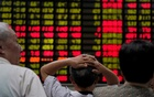 File Photo: Investors look at an electronic board showing stock information at a brokerage house in Shanghai, China Jun 20, 2018. Reuters