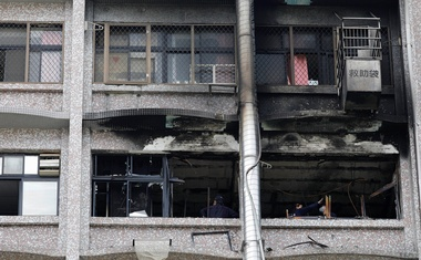 Fire inspectors view damage after a fire broke out at the Taipei Hospital, causing at least 9 people died in New Taipei City, Taiwan August 13, 2018. Reuters