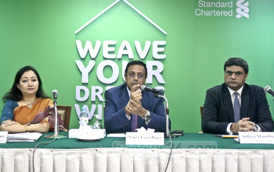 Standard Chartered Bangladesh's Head of Corporate Affairs Bitopi Das Chowdhury, CEO Naser Ezaz Bijoy and Head of Retail Banking Aditya Mandloi appeared before the press for the launch of MortgageOne, a home financing solution for the bank's retail clients, in Dhaka on Tuesday.