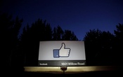FILE PHOTO: The sun rises behind the entrance sign to the Facebook headquarters in Menlo Park before the company's IPO launch, May 18, 2012. Reuters