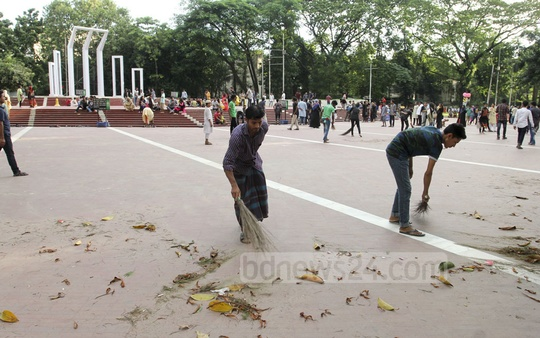 Members of BD Clean, a voluntary organisation, sweep the premises of the Central Shaheed Minar. Photo: Asif Mahmud Ove