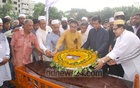 Colleagues pay their last respects to Golam Sarwar by placing wreaths on the coffin of the veteran journalist at a ground next to the Daily Samakal office at Tejgaon in Dhaka on Thursday.