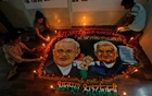 Students place candles around a painting featuring India's former prime minister Atal Bihari Vajpayee to pay him homage in Mumbai, India, August 16, 2018. Reuters