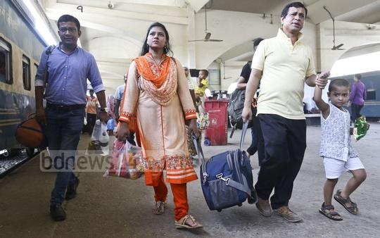 Eid travellers leave Dhaka by train from the Kamalapur Railway Station in Dhaka on Friday for their hometowns. Photo: Abdullah Al Momin