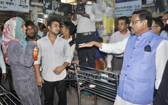 Road Transport Minister Obaidul Quader speaks to Eid travellers at the Mohakhali Bus Terminal on Friday.