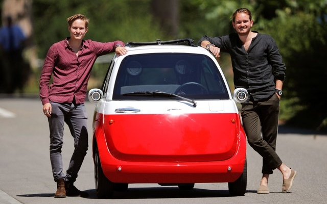 Chief Operating Officer Oliver (L) and his brother Chief Marketing Officer Merlin Ouboter of Swiss Microlino AG pose beside an electric-powered Microlino car in Kuesnacht, Switzerland July 13, 2018. Reuters