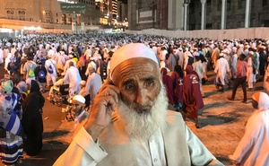 A Muslim pilgrim from Afghanistan speaks on the phone after night prays beside the Grand mosque ahead of annual Haj pilgrimage in the holy city of Mecca, Saudi Arabia Aug 16, 2018.Reuters