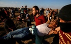 A wounded Palestinian is evacuated during a protest demanding the right to return to their homeland at the Israel-Gaza border, in Gaza Aug 17, 2018. Reuters