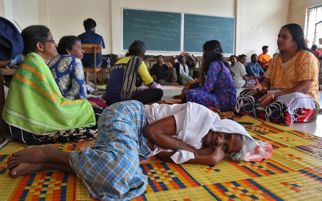 Flood victims rest inside a university classroom, which is converted into a temporary relief camp in Kochi in the southern state of Kerala, India, Aug 18, 2018. Reuters