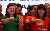 Davao City Mayor Sara Duterte-Carpio (L) and Ilocos Norte Governor Imee Marcos gestures during an alliance meeting with local political parties in Paranaque, Metro Manila in Philippines, August 13, 2018. Reuters