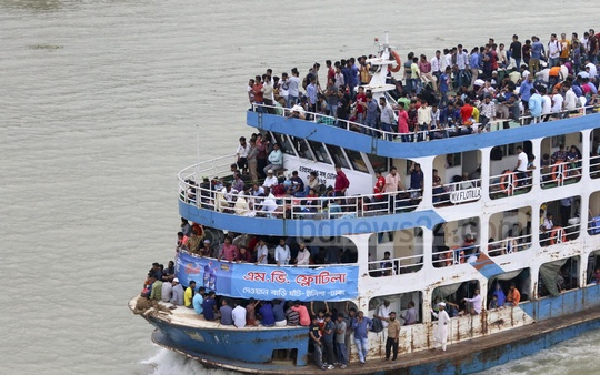 People crammed the roof of a passenger ferry for a ride back to their village and town homes. This photo was taken from the Bangladesh-China Friendship Bridge on Monday. Photo: Abdullah Al Momin