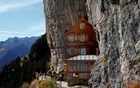 Hikers stand in front of the Berggasthaus Aescher-Wildkirchli guest house in the Alpstein mountain region near Weissbad, Switzerland October 28, 2016. Reuters